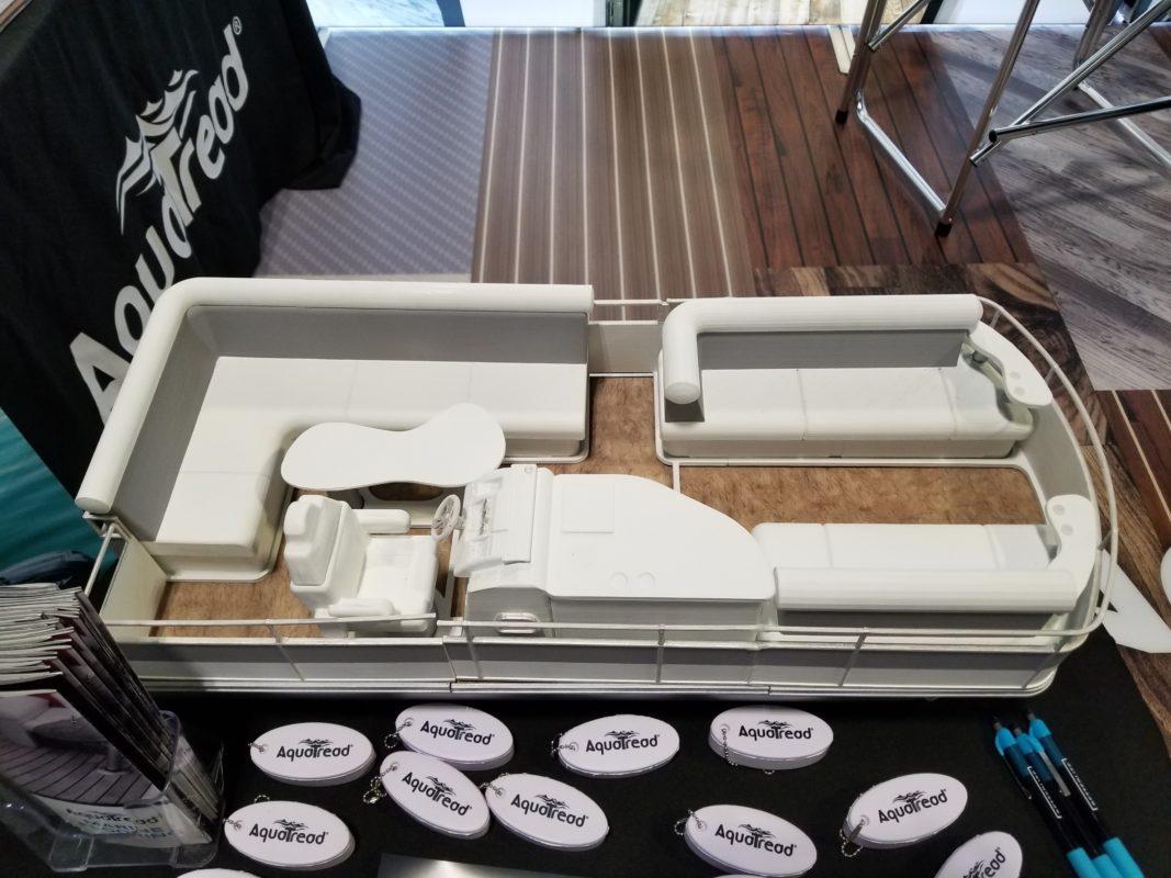 Miniature pontoon boat with marine flooring